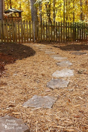Backyard Path Ideas this flagstone path uses pebbles to fill in the gaps between stones mulch path Add Stepping Stones To Your Mulch Path For More Visual Interest And A Firm Place To Step