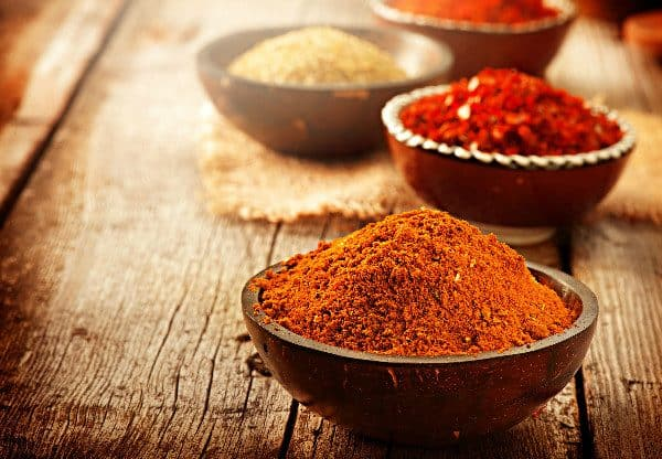 Cinnamon, mint, and cayenne pepper all work as great natural ant repellants.