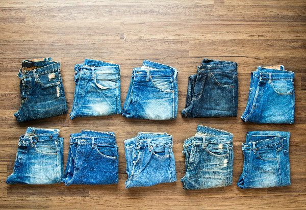 You can unshrink clothes like denim jeans using warm water and ingenuity.