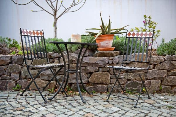 How to clean patio furniture: clean wrought iron regularly to avoid rust buildup.